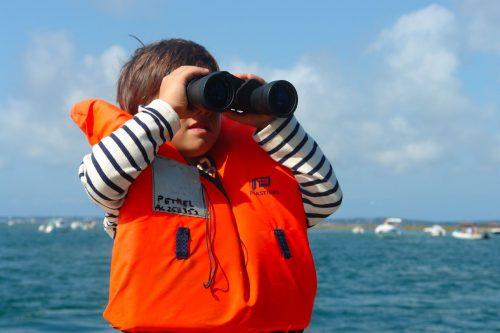 Un enfant lors du Tour de l'Île aux Oiseaux